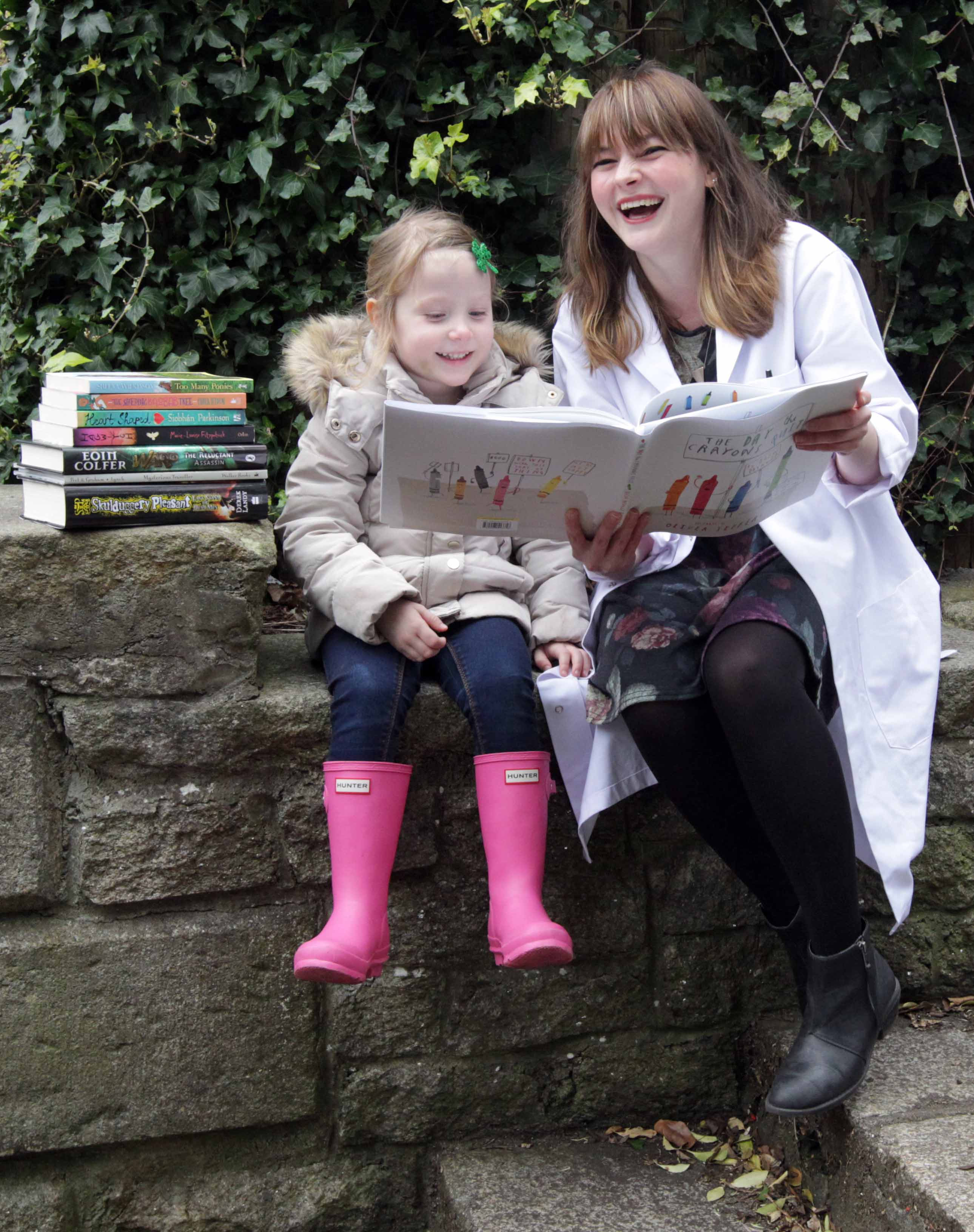 NO REPRO FEE 18/3/2014 Children's Books Ireland Book of the Year Award. Three-year-old Nahla Burke and Children's Books Ireland Book Doctor Kim Harte celebrate the eight books shortlisted for the Children's Books Ireland Book of the Year Award. The eight shortlisted books are 'The Sleeping Baobab Tree' by Paula Leyden, 'Warp The Reluctant Assassin' by Eoin Colfer, 'Heart Shaped' by Siobhan Parkinson, 'Hagwitch' by Marie-Louise Fitzpatrick, 'Too Many Ponies' by Sheena Wilkinson, 'Skulduggery Pleasant Last Stand of Dead Men' by Derek Landy, 'Mysterious Traveller' illustrated by P.J. Lynch, 'The Day the Crayons Quit' illustrated by Oliver Jeffers. Photo: Mark Stedman/Photocall Ireland
